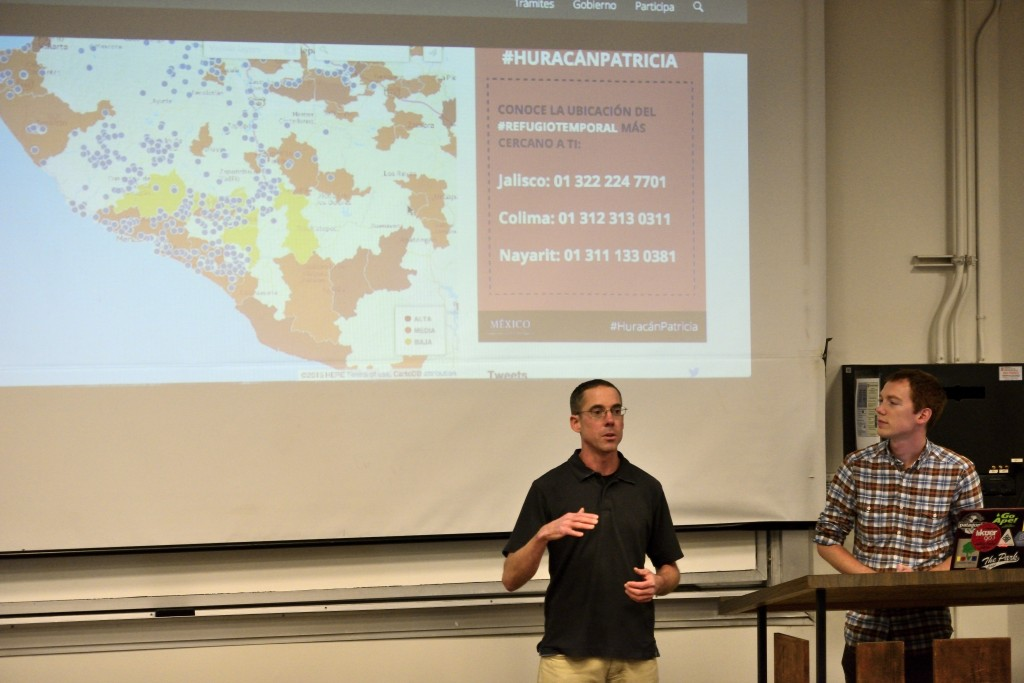 Seth Bishop, Graduate student in the Geography Department, and Tim Edgar, Doctoral candidate in the Geography Department, explain to students how to use the OpenStreetMaps to help map the Hurricane damaged region in Mexico in OSH on Monday, Oct. 26, 2015