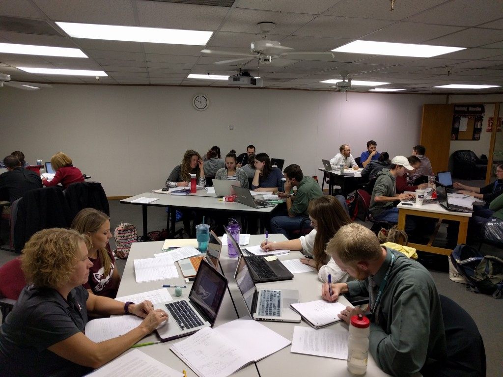 2015 cohort working on understanding conic sections' different definitions and interpretations.