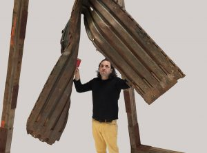 Guillermo Galindo, Angel Exterminador (wall gong), 2015, discarded old border wall section.