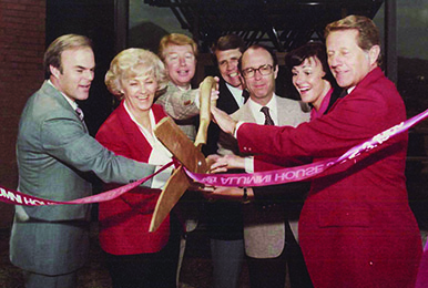 Spencer F. Eccles (far left) led the successful campaign to raise funds for the original Alumni House, which opened with this ribbon-cutting ceremony in 1980. Also pictured, from left to right: Afton B. Bradshaw, R.J. Snow, Howard A. Jorgensen, U President David P. Gardner, Anne Decker, and D. Brent Scott.