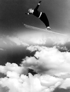 Ski jumping medalist Alf Engen, airborne, 1930s. From the Alf K. Engen photograph collection.