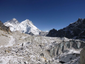 Changri Nup Glacier, one of the hundreds studied by the researchers. Much of it is covered by rocky debris. The peak of Mt. Everest is in the background at left.