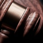A close-up of a judge's gavel