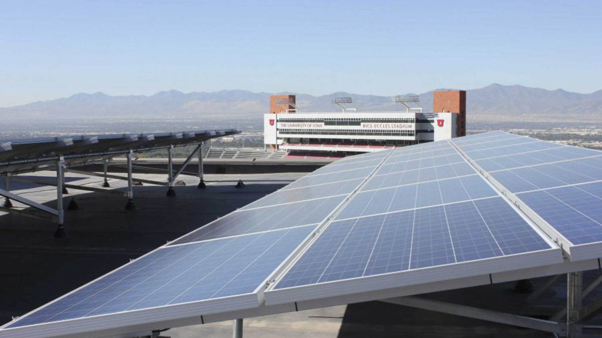 Solar panels on the roof of the J. Willard Marriott Library looking west with the Rice-Eccles Stadium and Salt Lake Valley in the background.
