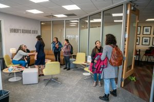 People gather in the lobby of the newly remodeled Women's Resource Center