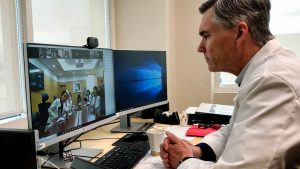 Dr. Mike Good collaborates with doctors in South Korea via video conference.