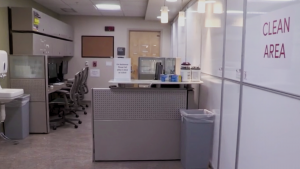 "photo of an office space with sign on white board that reads, ""Clean Area."""