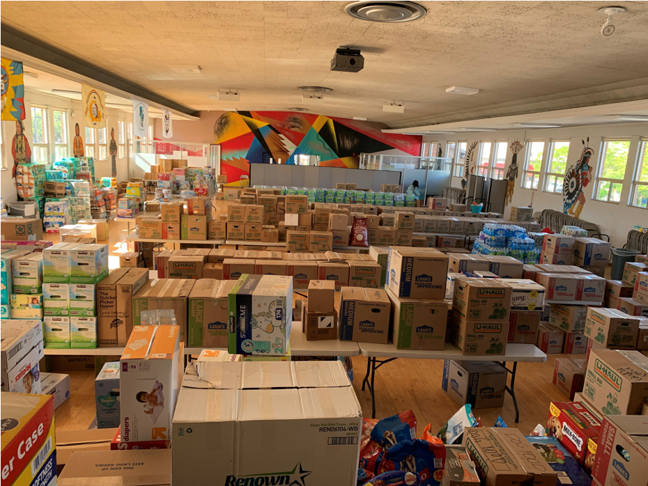 warehouse filled with boxes of donated supplies.