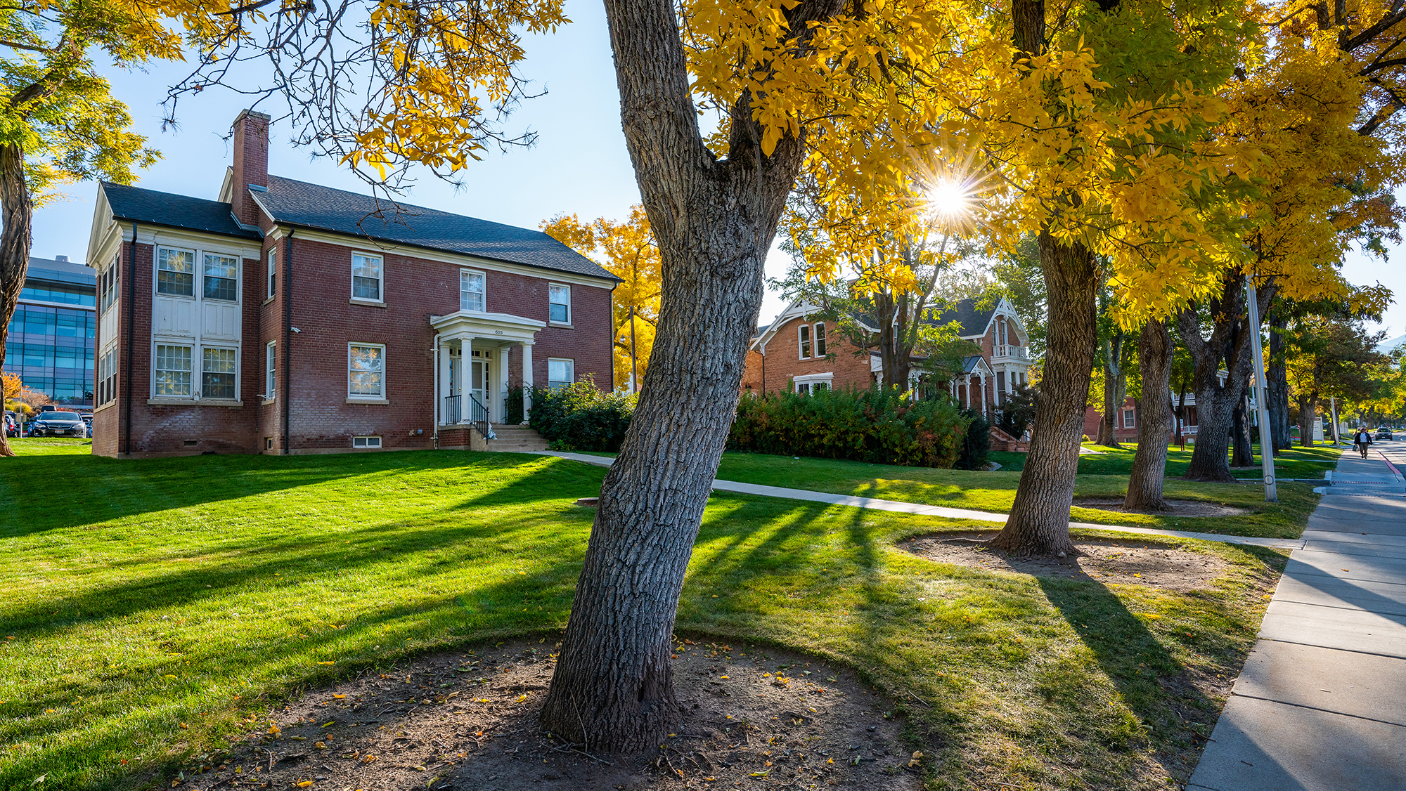 photo of the black cultural center on the University of Utah's campus with fall leaves on the trees outside the red brick building.