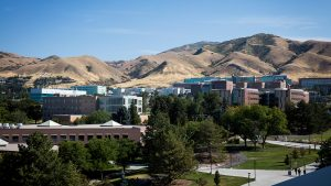 View of University of Utah campus including several buildings and the hills to the East and the white block U on the hillside.