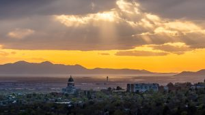 view of Utah's downtown and capitol building from University of Utah campus at sunset