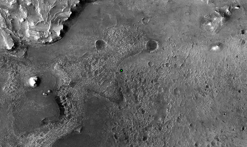 The surface of Mars, a black and white photo with two craters and geologic features.