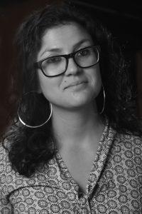 black and white headshot of Ana Antunes.