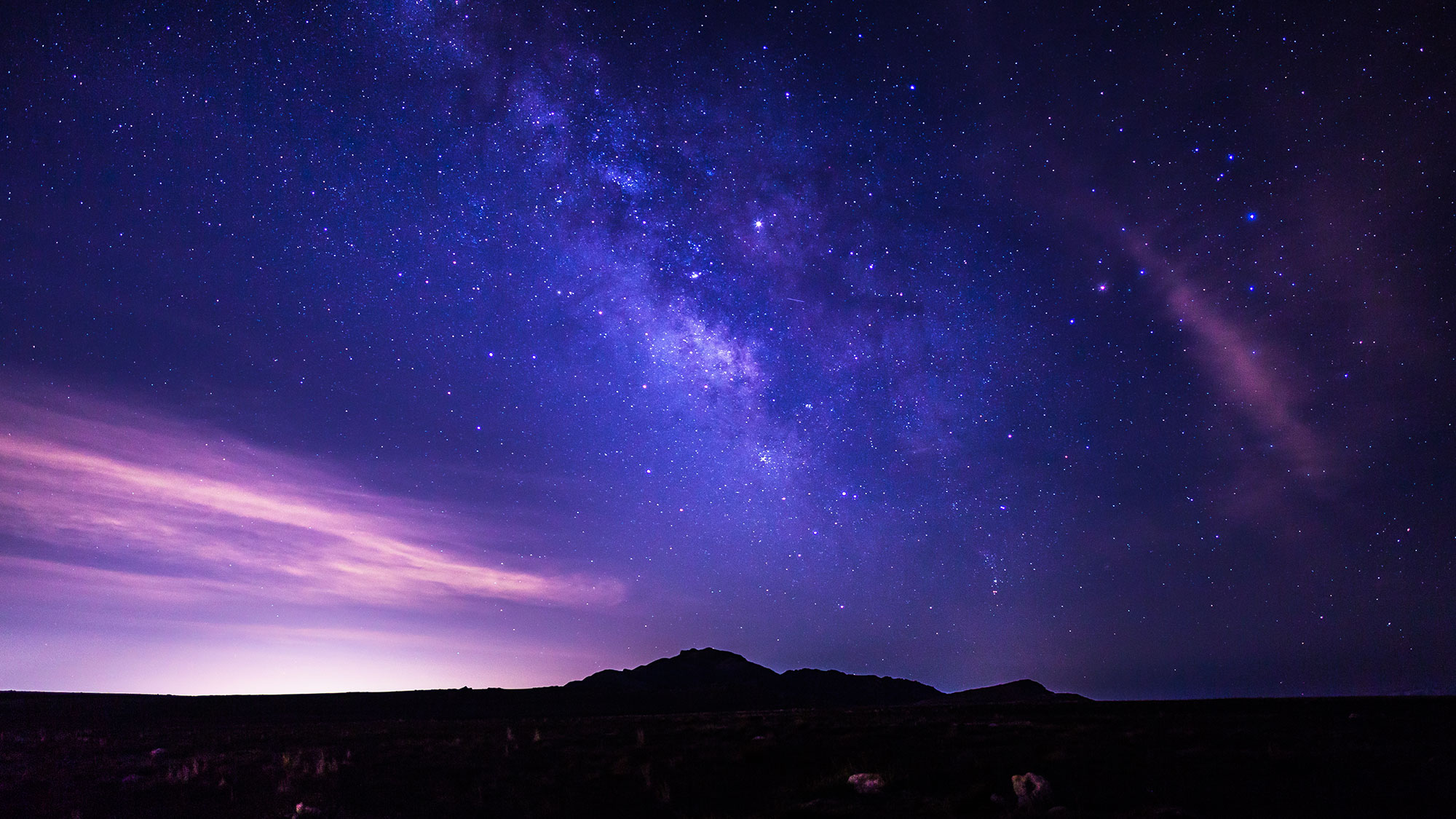 A landscape of the dark skies. You see an arm of the Milky Way Galaxy.
